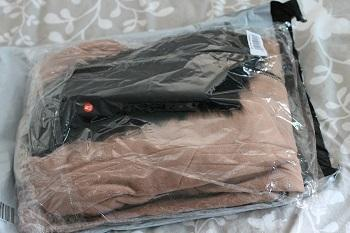 The coat wraped up in plastic